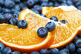 Freshly picked blueberries with orange