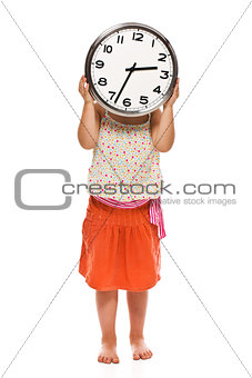 Little girl holding a wall clock in his hand