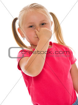 little girl covering nose