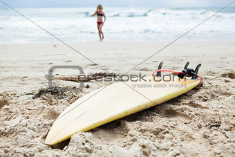 Surfboard in sand on beach
