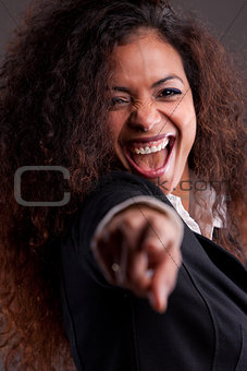 Beautiful smiling woman pointing finger