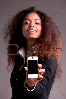 Beautiful afroamerican woman showing phone