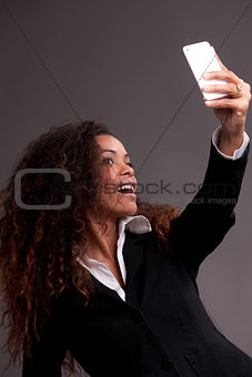 Beautiful woman smiling at her phone