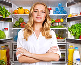 Healthy woman near open fridge
