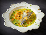 Pan-fried sea trout in green sauce