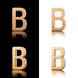 Three dimensional wooden letter B. Isolated on white and black.
