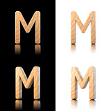 Three dimensional wooden letter M. Isolated on white and black.