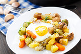 Baked eggs with vegetables and mushrooms