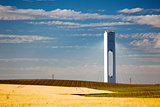 Solar Tower with rays  - thermo-solar power - blue sky and yello