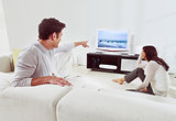 couple on sofa and watching tv