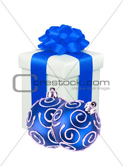 beautiful gift with blue ribbon and christmas balls isolated on
