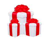 gift boxes with red bow isolated on white