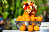 Beautiful bridal bouquet and oranges outdoors