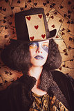 Vintage jester woman wearing the card of hearts