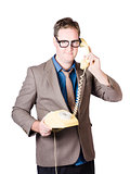 Businessman talking on retro telephone