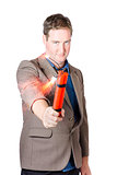 Hostile male office worker holding flaming bomb