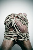 man hands tied with string