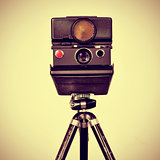 old instant camera in a tripod
