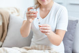 Woman filling syringe with medicines