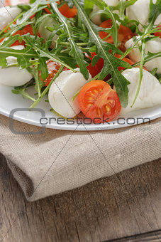 salad from arugula tomatos and baby mozzarella