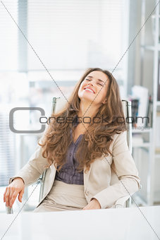 Portrait of relaxed business woman sitting in office