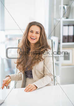 Portrait of happy business woman sitting in office