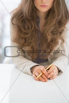 Closeup on business woman sitting at desk