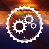 Cogwheel Gear Icon on Triangle Background.