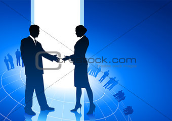 businessman and businesswoman shaking hands internet background