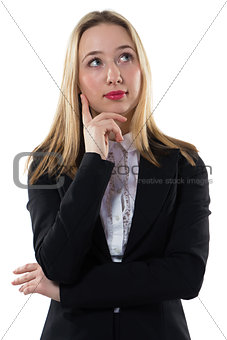 Thoughtful businesswoman with arms crossed