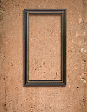 Concrete texture and wooden frame