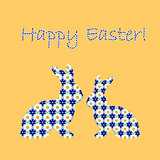 Silhouette of two Easter bunny rabbits decorated with cornflower