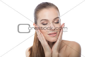 Attractive woman touching her face