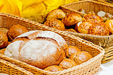 wicker basket full of bread and rolls