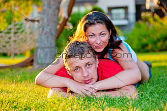 husband and wife relaxing on the green lawn