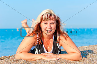 portrait of a beautiful woman on sea background