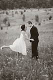 Young wedding couple outdoor. Groom and bride together.
