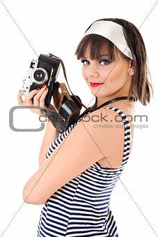 Beautiful girl holding old camera