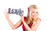 Fun blonde woman with love word sign