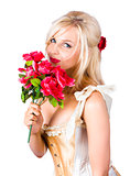 Adorable florist woman smelling red flowers