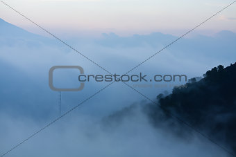 Fog approaching volcano slopes Guatemala