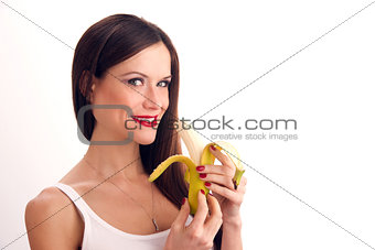 Attractive Woman eats RAW food fruit banana white background