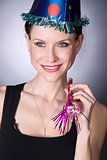 Pretty Woman has Fun in a New Years Eve Celebration Party Hat an