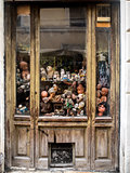 Window with worn out dolls