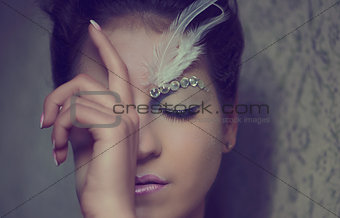 Beautiful girl portrait close-up with an extravagant make-up