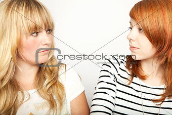 blond and red haired girl are upset