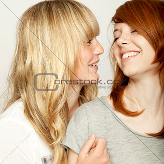 blond and red haired girls are laughing