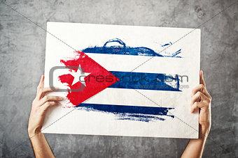Cuba flag. Man holding banner with Cuban Flag.