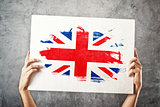 Great Britain flag. Man holding banner with British Flag.