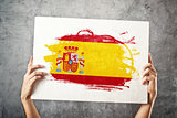 Spain flag. Man holding banner with Spanish Flag.